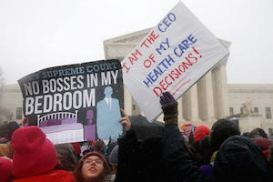 Demonstrators outside of the Supreme Court earlier this week. Image credit: Charles Dharapak/AP